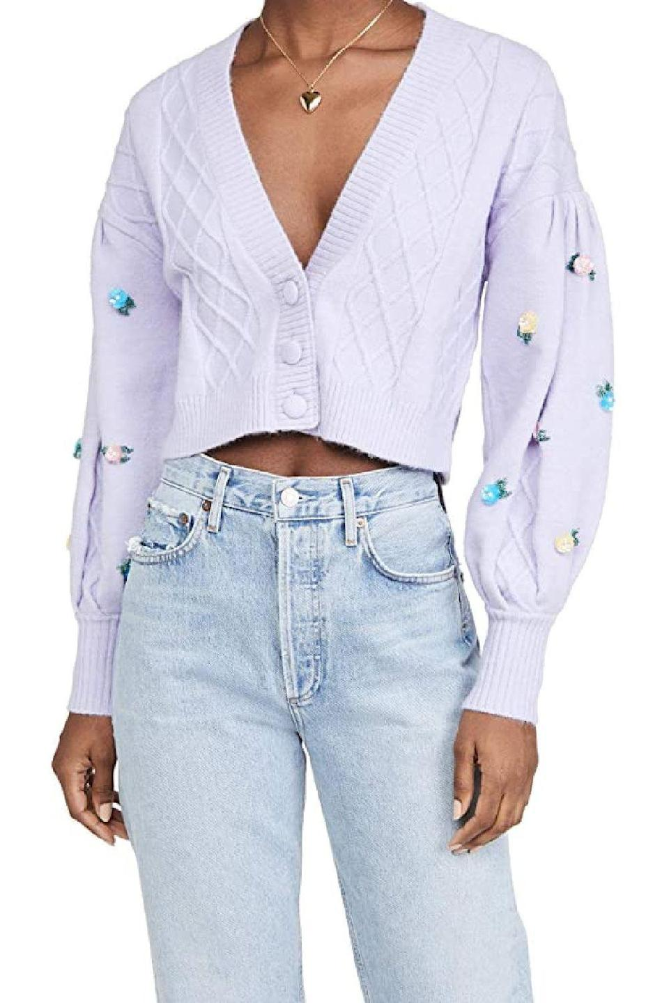 """<p><strong>For Love & Lemons</strong></p><p>amazon.com</p><p><strong>$194.00</strong></p><p><a href=""""https://www.amazon.com/dp/B08JXB88BN?tag=syn-yahoo-20&ascsubtag=%5Bartid%7C10049.g.36149947%5Bsrc%7Cyahoo-us"""" rel=""""nofollow noopener"""" target=""""_blank"""" data-ylk=""""slk:Shop Now"""" class=""""link rapid-noclick-resp"""">Shop Now</a></p><p>Not your grandma's fave floral sweater, this cable knit cropped cardigan is much cooler (no offense, g-ma) and perfect for wearing with jeans or layering over dresses.</p>"""