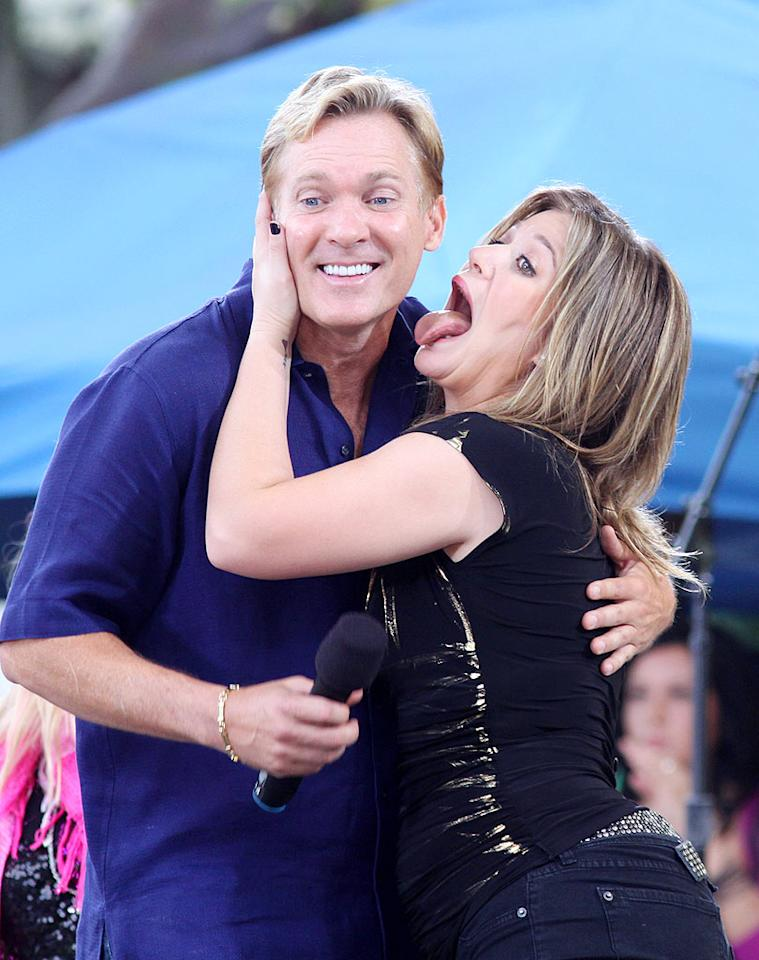 "Kelly pretends to plant a sloppy kiss on ""Good Morning America"" weatherman Sam Champion. Janet Mayer/<a href=""http://www.splashnewsonline.com"" target=""new"">Splash News</a> - July 31, 2009"