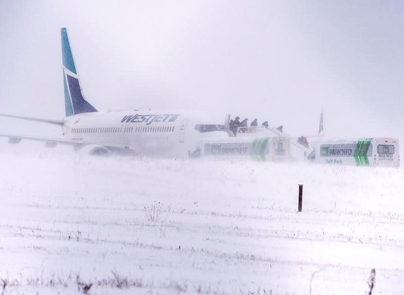 Passengers removed from WestJet aircraft after it skids off Halifax runway