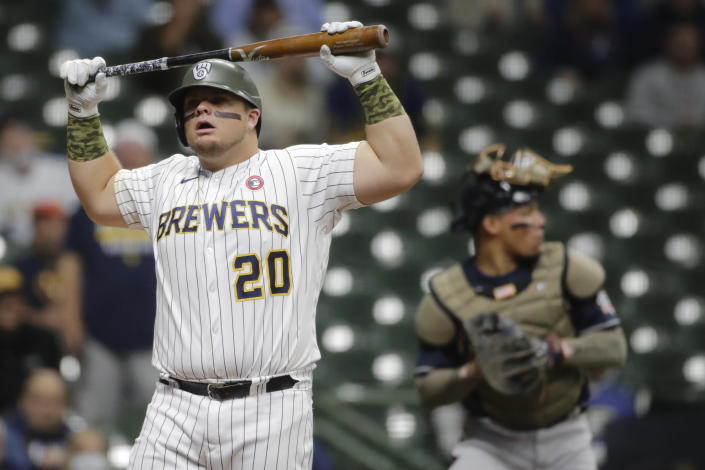Milwaukee Brewers' Daniel Vogelbach reacts after striking out during the first inning of the team's baseball game against the Atlanta Braves on Saturday, May 15, 2021, in Milwaukee. (AP Photo/Aaron Gash)