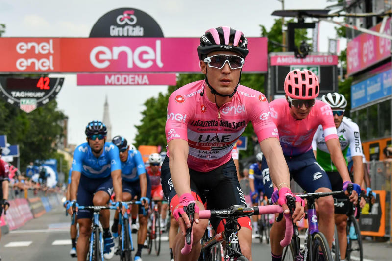Italy's Valerio Conti wears the pink jersey of the overall leader after completing the 10th stage of the Giro d'Italia cycling race from Ravenna to Modena, Italy, Tuesday, May 21, 2019. (Alessandro Di Meo/ANSA via AP)