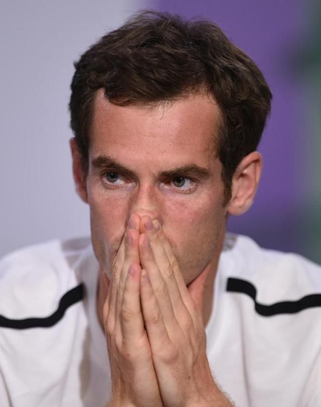 Britain's Andy Murray attends a press conference after being defeated by Bulgaria's Grigor Dimitrov at the All England Lawn Tennis Championships in Wimbledon, London, Wednesday July 2, 2014. (AP Photo/AELTC, Billie Weiss)