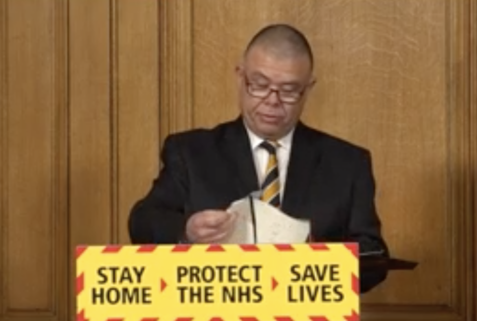 Prof Jonathan Van-Tam reads from the paracetamol sheet at Wednesday's Downing Street press conference. (BBC)