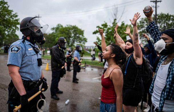 PHOTO: Protesters and police face each other during a rally for George Floyd in Minneapolis, May 26, 2020. (Richard Tsong-Taatarii/Star Tribune via AP)