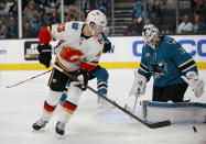 Calgary Flames' Sam Bennett (93) shoots the puck at the net as San Jose Sharks goaltender Martin Jones (31) makes the save in the first period of an NHL hockey game in San Jose, Calif., Sunday, Nov. 11, 2018. (AP Photo/Josie Lepe)