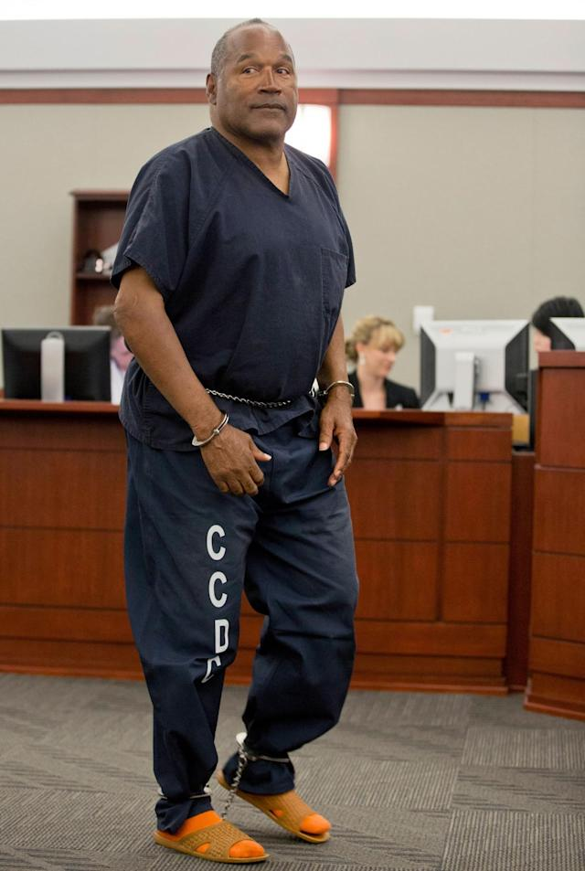 <p>O.J. Simpson returns to the witness stand to testify after a break during an evidentiary hearing in Clark County District Court in Las Vegas, Nev., May 15, 2013. (Photo: Julie Jacobson, Pool/AP) </p>