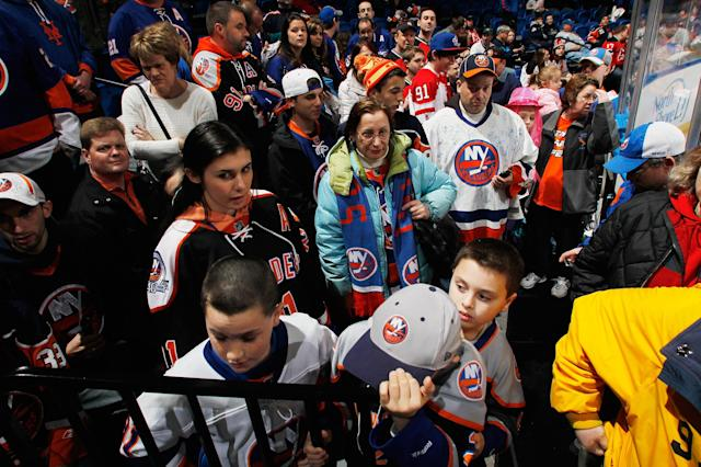 UNIONDALE, NY - JANUARY 19: Fans of the New York Islanders await the start of 2102-2013 NHL season prior to the Islanders home opener against the New Jersey Devils at the Nassau Coliseum on January 19, 2013 in Uniondale, New York. (Photo by Andy Marlin/Getty Images)