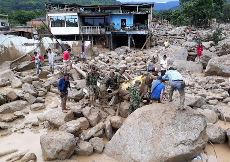 Desperate Search for Survivors as Death Toll in Colombia Mudslide Tops 200