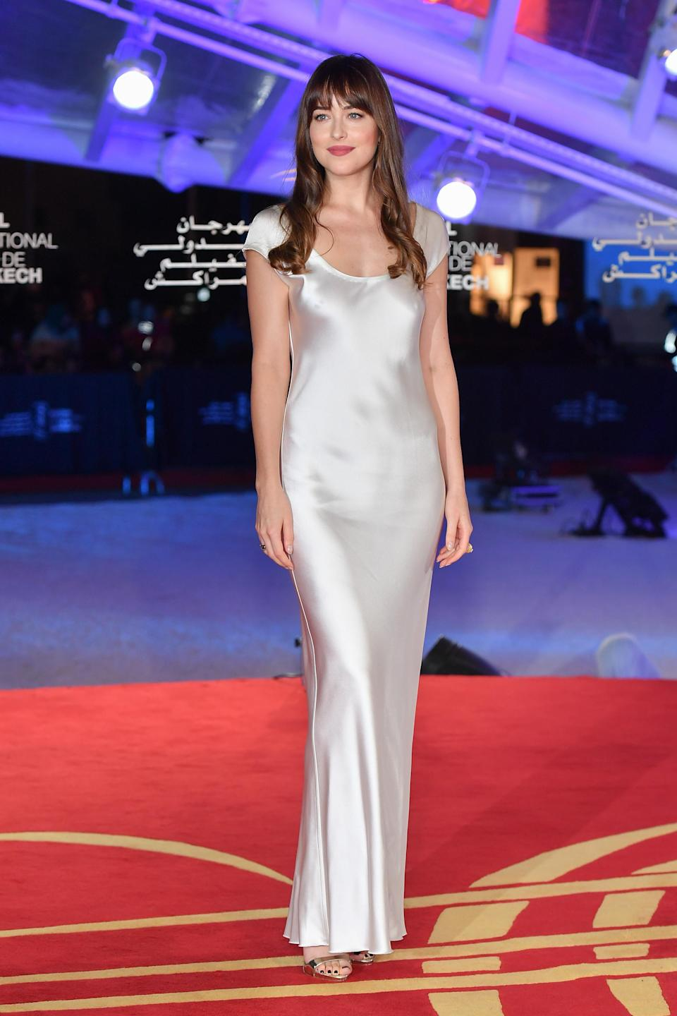 <p>Clad in a silvery, form-fitting dress by Bevza, the American star demonstrated the art of festive party dressing on the red carpet in Morocco. <em>[Photo: Getty]</em> </p>