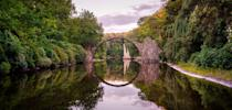 <p>The bridge makes a perfect circle with it's own reflection. (Photo: Roman Robroek/Caters News) </p>