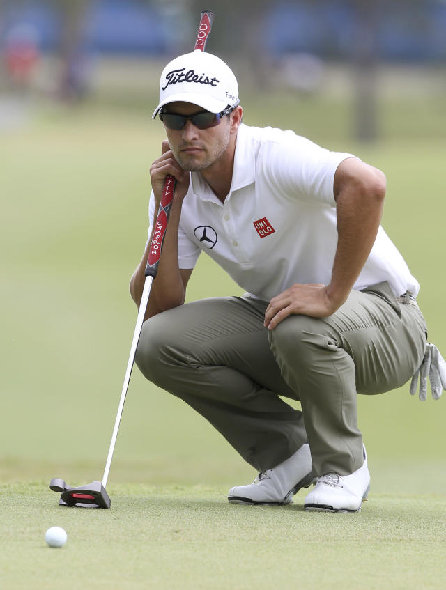 Adam Scott of Australia lines up a putt on the 10th green during the final round of the Australian PGA golf championship held at the Royal Pines Resort, on the Gold Coast, in Australia, Sunday, Nov. 10, 2013. (AP Photo/Tertius Pickard)