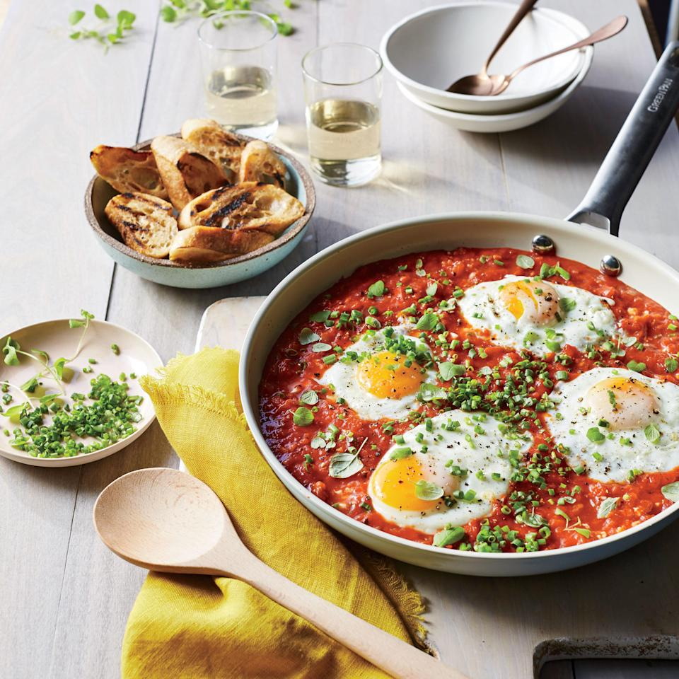 """If you've ever had Italian eggs in purgatory, this recipe makes a similar Israeli breakfast dish called shakshuka. If you need to stretch the meal, simply add another egg to the pan. Top with any herb, such as cilantro, chives, or oregano. <a rel=""""nofollow"""" href=""""http://www.myrecipes.com/recipe/saucy-skillet-poached-eggs"""">Saucy Skillet-Poached Eggs </a>"""
