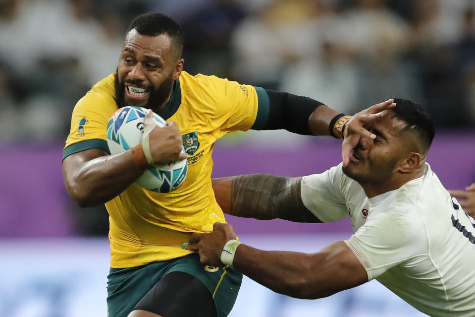 FILE - In this Oct. 19, 2019 file photo, Australia's Samu Kerevi fends off an England's Manu Tuilagi during the Rugby World Cup quarterfinal match at Oita Stadium in Oita, Japan. Kerevi has been named in the Australian 7's squad for the Tokyo Olympics. (AP Photo/Christophe Ena,File)