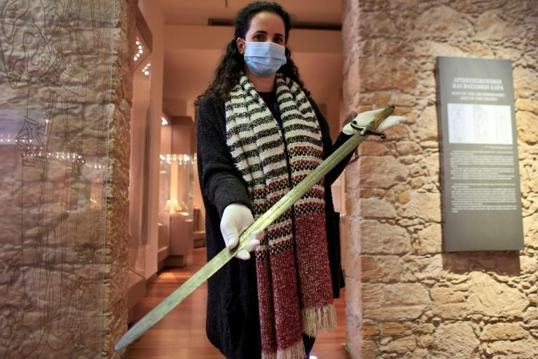 Maria Patsalosavvi, curator of the Leventis Municipal Museum in the Cypriot capital Nicosia, displays a crusader sword donated by Constantinos Emilianides, a private collector
