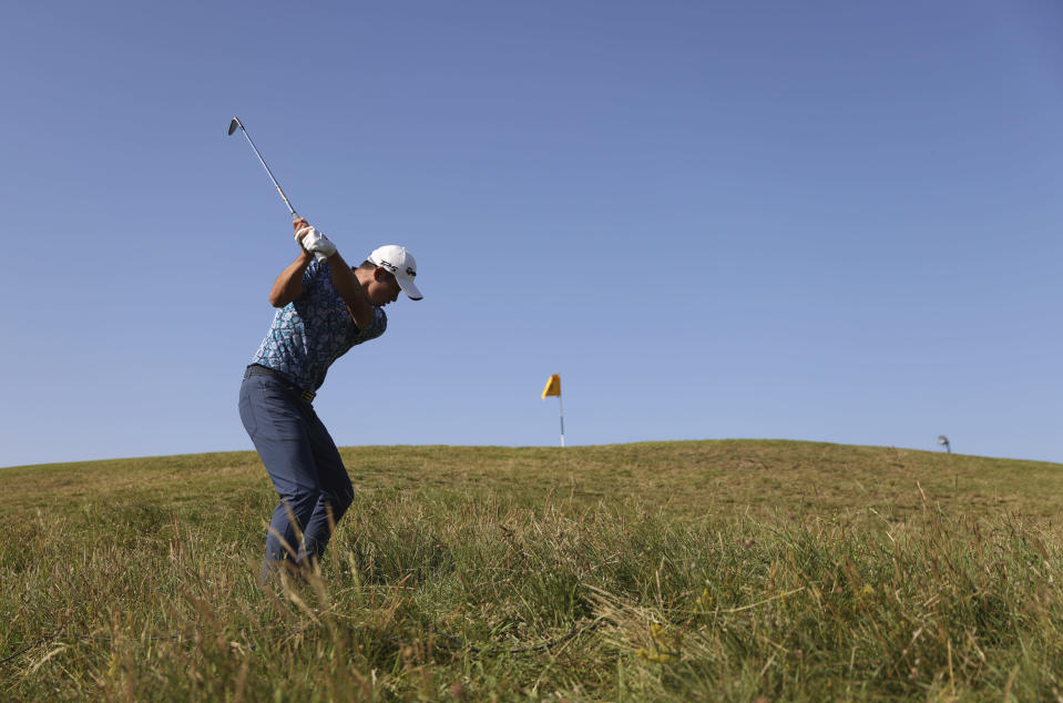 United States' Collin Morikawa plays a shot on the 10th from the rough during the final round of the British Open Golf Championship at Royal St George's golf course Sandwich, England, Sunday, July 18, 2021. (AP Photo/Peter Morrison)