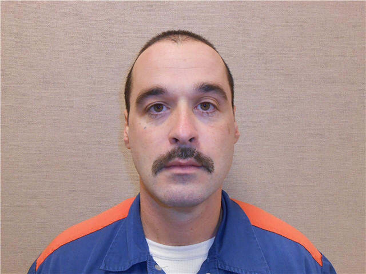 This Feb. 11, 2013 photo provided by the Michigan Department of Corrections shows Michael David Elliot. Elliot, who is serving life behind bars for murder in four 1993 deaths in Michigan, has escaped from prison and may have abducted a woman before she got away in Indiana, according to officials. Michigan Department of Corrections spokesman Russ Marlan says in an email that 40-year-old Elliot was discovered missing about 9:30 p.m. Sunday, Feb. 2, 2014, from the Ionia Correctional Facility in mid-Michigan. (AP Photo/Michigan Department of Corrections)