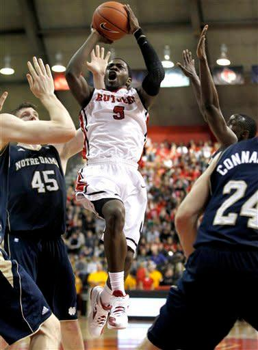 Rutgers guard Eli Carter (5) goes up for a shot against Notre Dame during the second half of an NCAA college basketball game, Monday, Jan. 16, 2012, in Piscataway, N.J. Rutgers won 65-58. (AP Photo/Julio Cortez)