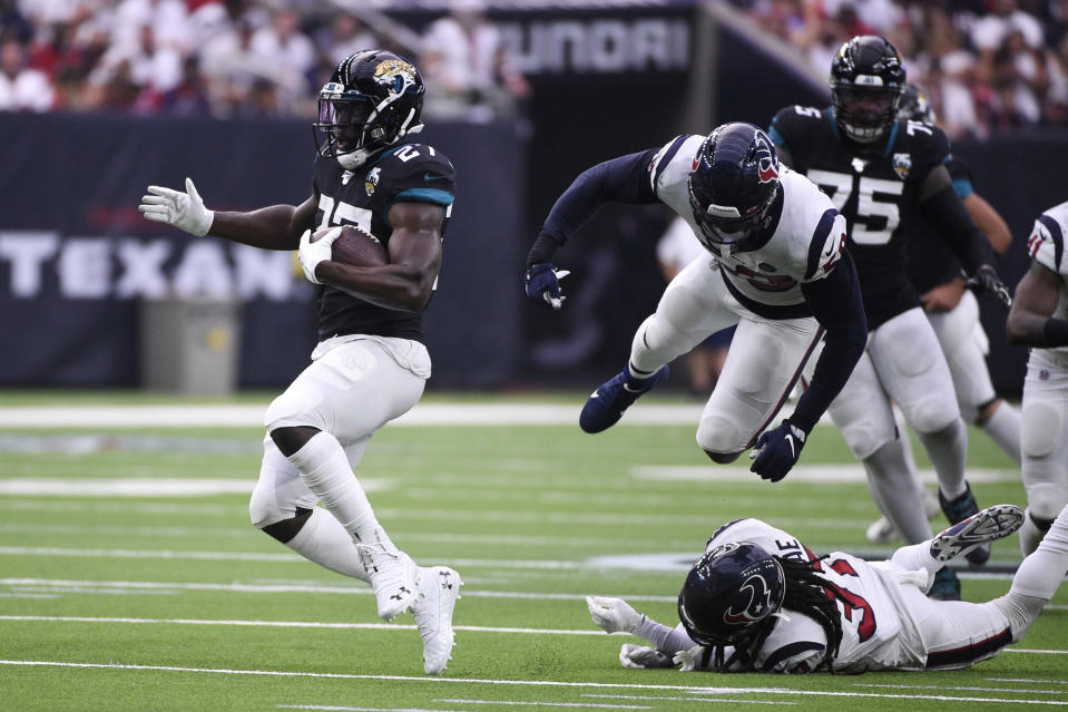 Jacksonville Jaguars running back Leonard Fournette (27) runs against the Houston Texans during the first half of an NFL football game Sunday, Sept. 15, 2019, in Houston. (AP Photo/Eric Christian Smith)