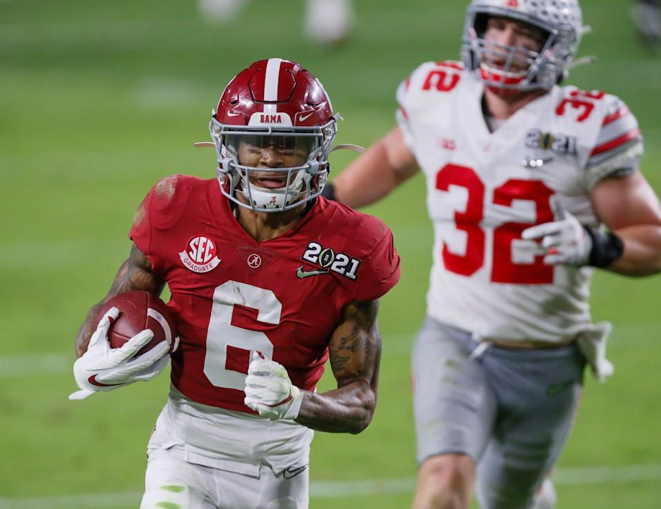 Alabama receiver DeVonta Smith catches a 42-yard touchdown behind Ohio State linebacker Tuf Borland during the second quarter of the College Football Playoff National Championship Game, Jan. 11, 2021 in Miami Gardens, Fla.