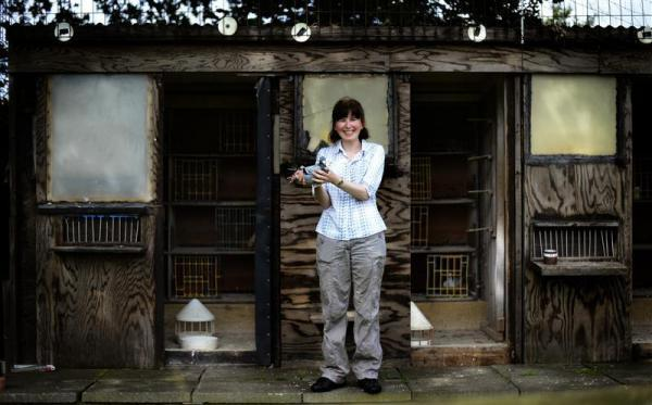 Pigeon fancier Katie Adwas poses at her loft in Knayton, northern England August 21, 2012. Topcliffe club secretary Adwas has been racing since 1996 and spends 15 hours a week on her 100 pigeons. Over recent years, the club has dwindled to just nine members.