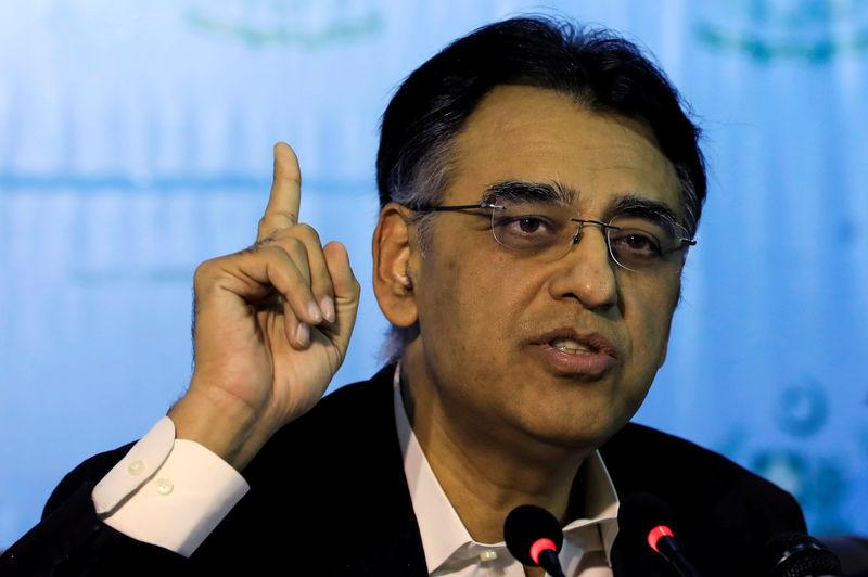 FILE PHOTO: Pakistan's Finance Minister Asad Umar gestures during a news conference in Islamabad