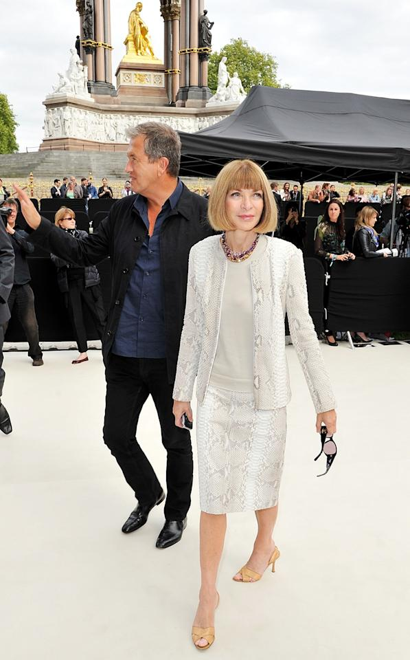 """<p class=""""MsoNormal""""><span>Vogue editor Anna Wintour arrived at the Burberry Spring Summer 2013 Womenswear Show, one of many the fashion maven attended, with famed British fashion photographer Mario Testino. <br></span></p><p class=""""MsoNormal""""><span>(Photo by Dave M. Benett/Getty Images for Burberry)</span></p>"""