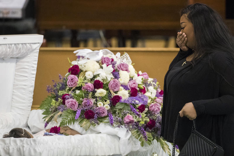 A mourner approaches the casket of Jazmine Barnes during a viewing ceremony before the memorial services on Tuesday Jan. 8 2019 at the Community of Faith Church in Houston. Barnes was fatally shot Dec. 30 2019 while in a car with her family during