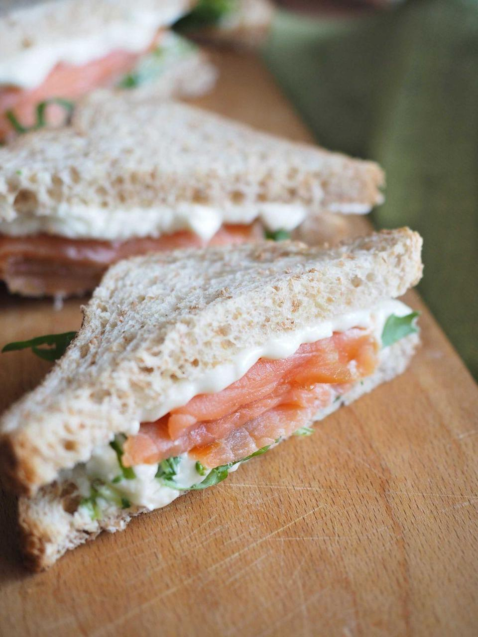 """<p><strong>Smoked Salmon Sandwich</strong></p><p>The Smoked Salmon Sandwich on wheat became Washington's official sandwich in 1987. But lawmakers say, the condiments are your choice. A great dish at <a href=""""https://www.pikeplacechowder.com/"""" rel=""""nofollow noopener"""" target=""""_blank"""" data-ylk=""""slk:Pike Place Chowder"""" class=""""link rapid-noclick-resp"""">Pike Place Chowder</a> to eat for breakfast or lunch we recommend to top your sandwich with capers. </p>"""