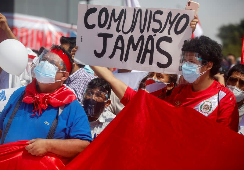 FILE PHOTO: People protest against Peru's presidential socialist candidate Pedro Castillo, in Lima