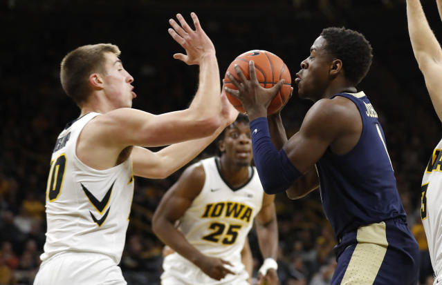 Pittsburgh guard Xavier Johnson drives to the basket in front of Iowa guard Joe Wieskamp, left, during the first half of an NCAA college basketball game, Tuesday, Nov. 27, 2018, in Iowa City, Iowa.(AP Photo/Charlie Neibergall)