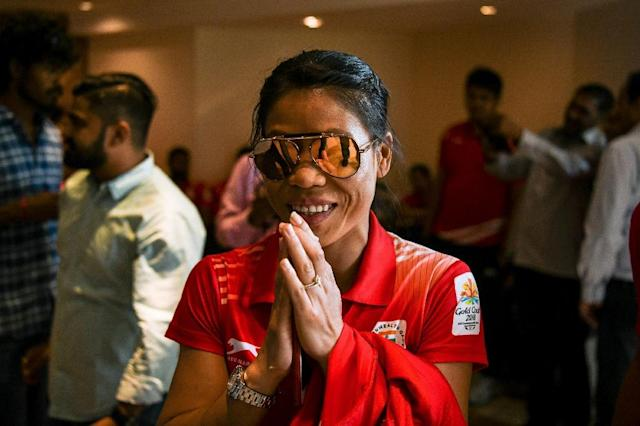 Indian boxer Mary Kom gestures as she arrives at a ceremony for the victorious Indian boxing contingent at the 2018 Commonwealth Games (AFP Photo/CHANDAN KHANNA)
