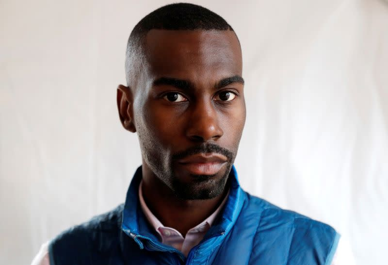 """FILE PHOTO: Civil rights activist DeRay Mckesson poses for a portrait during the """"End Racism Rally"""" on the 50th anniversary of the assassination of civil rights leader Rev. Martin Luther King Jr. in Washington"""