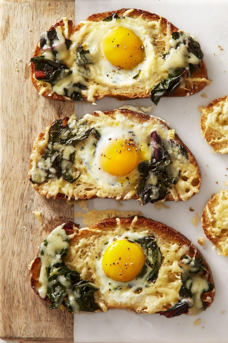 "<p>Amp-up the kid-friendly classic with earthy greens and nutty cheese. Now adults will love it too!</p><p><em><a href=""https://www.goodhousekeeping.com/food-recipes/a43666/chard-gruyere-eggs-in-the-hole-recipe/"" rel=""nofollow noopener"" target=""_blank"" data-ylk=""slk:Get the recipe for Chard and Gruyère Eggs in the Hole »"" class=""link rapid-noclick-resp"">Get the recipe for Chard and Gruyère Eggs in the Hole »</a></em></p>"
