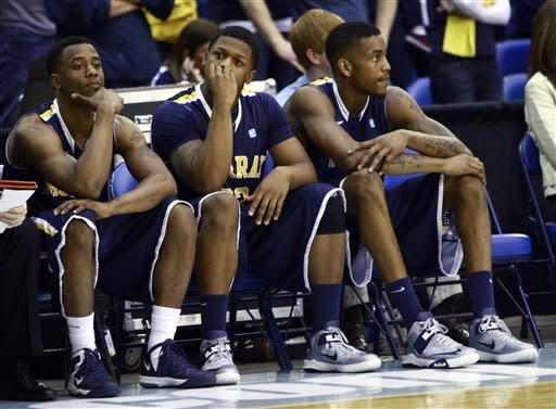 Murray State player's wait out the final seconds of an NCAA college basketball game against Belmont in the Ohio Valley Conference tournament championship on Saturday, March 9, 2013, in Nashville, Tenn. Belmont won in overtime 70-68. (AP Photo/Wade Payne)