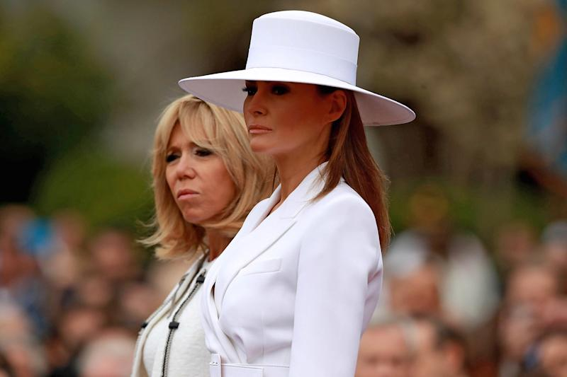 U.S. first lady Melania Trump and Brigitte Macron take part in a state arrival ceremony at the White House April 24, 2018 in Washington, DC.