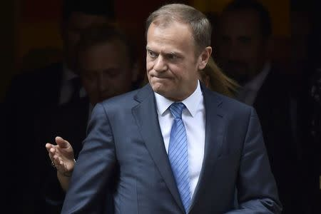 Donald Tusk, the President of the European Council, leaves after meeting Britain's Prime Minister, Theresa May inside 10 Downing Street, in central London