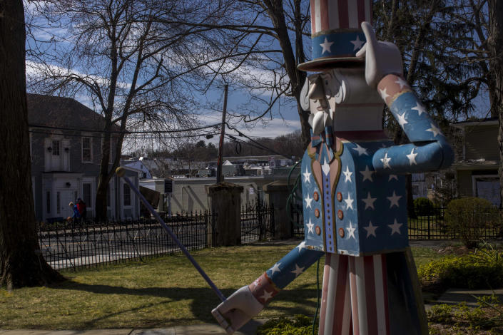 A statue in front of the Westport Museum for History and Culture, which was closed because of the coronavirus pandemic, March 22, 2020. (Dave Sanders/The New York Times)