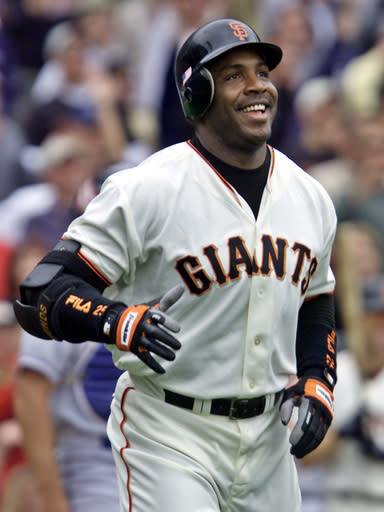 FILE - In this Oct. 7, 2001, file photo, San Francisco Giants' Barry Bonds smiles as he begins to round the bases after he hit his 73rd home run of the season, against the Los Angeles Dodgers in a baseball game in San Francisco. The baseball Hall of Fame wont have any new players in the class of 2021 after voters decided no one had the merits on-the-field or off for enshrinement in Cooperstown on this year's ballot. Curt Schilling, Bonds and Roger Clemens were the closest in voting by members of the Baseball Writers' Association of America released Tuesday, and the trio will have one more chance at election next year. It's the first time the BBWAA didn't choose anyone since 2013. (AP Photo/Eric Risberg, File)