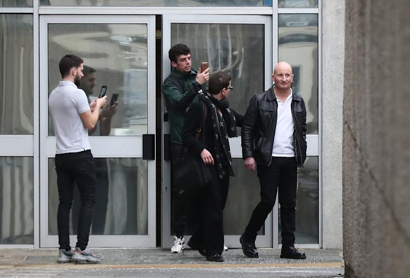 Steve Bouquet (right) is escorted away from Brighton Magistrates Court after appearing on 16 counts of criminal damage over attacks in Brighton on cats between October 2018 and June 2019.