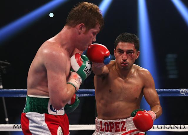 LAS VEGAS, NV - SEPTEMBER 15: (R-L) Josesito Lopez lands a right to the head of Canelo Alvarez during their WBC super welterweight title fight at MGM Grand Garden Arena on September 15, 2012 in Las Vegas, Nevada. (Photo by Josh Hedges/Getty Images)