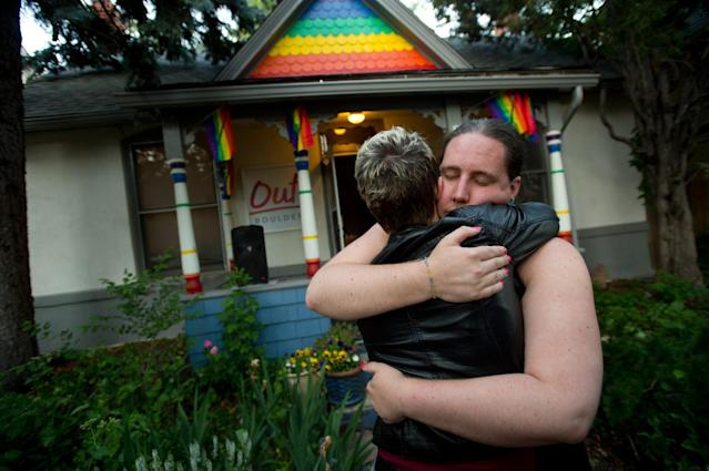 <p>Sara Connell, education and services manager for Out Boulder, hugs Leslie McCormick during a vigil in Boulder, Colo., for the victims of the mass shooting in Orlando, Fla., June 12, 2016. (Autumn Parry/Daily Camera via AP) </p>