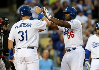 Yasiel Puig (R) and Joc Pederson celebrate after a home run. (Getty)