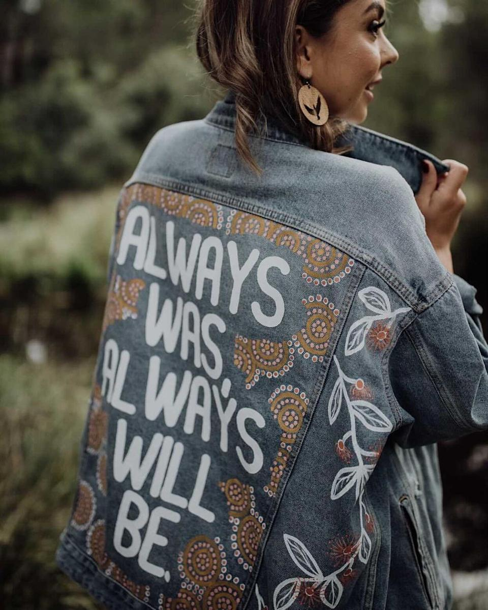 """Ginny is a proud Gomaroi/ Gamilaraay woman from Brisbane, Australia who started her business after having a """"crazy idea to paint a jacket"""" as a gift for her best friend. Photo: Instagram/Ginny's Girl Gang"""