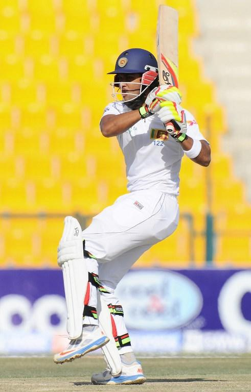 Sri Lankan batsman Dinesh Chandimal plays a shot during the fourth day of the first cricket Test match between Pakistan and Sri Lanka at the Sheikh Zayed Stadium in Abu Dhabi on January 3, 2014. Pakistan's last six wickets fell cheaply on the third morning of the first Test and restrict them to 383.  Sri Lanka were bowled out for 204 in their first innings of the first Test against Pakistan in Abu Dhabi.  AFP PHOTO/Ishara S. KODIKARA