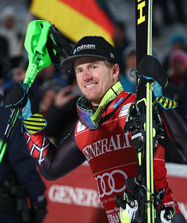 Ted Ligety, of the US, smiles at the finish area after taking second place in an alpine ski men's World Cup super-combined in Kitzbuehel, Austria, Sunday, Jan. 26, 2014. (AP Photo/Giovanni Auletta)