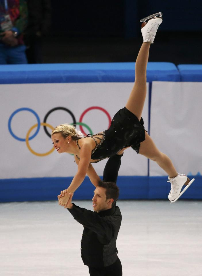 Kirsten Moore-Towers and Dylan Moscovitch of Canada compete during the Team Pairs Free Skating Program at the Sochi 2014 Winter Olympics