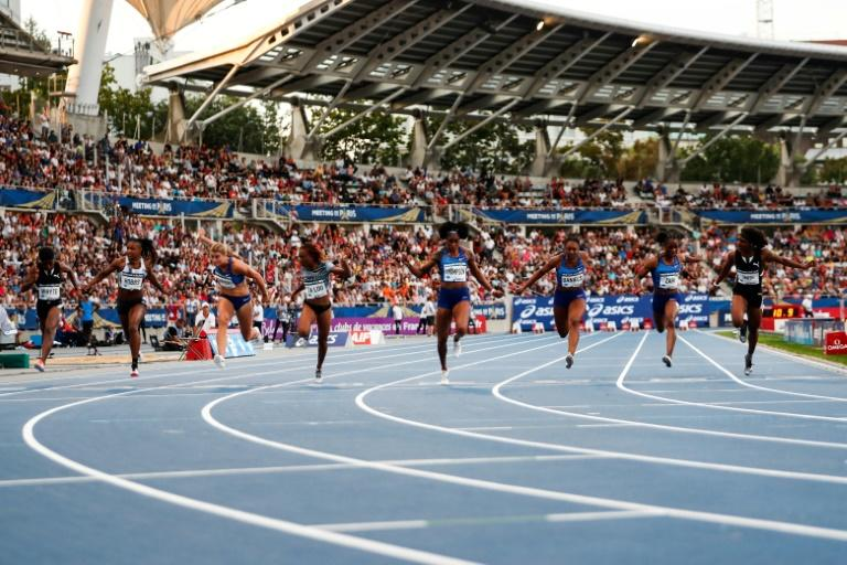 Action in the women's 100m won by Elaine Thompson