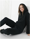 """<p>The ASOS Loungeable Fleece Lounge Set is basically the grown-up alternative to cuddling up with your favorite teddy bear. The pants have a slightly tapered leg with an elastic waistband so the fit is as cute as it is comfortable. Up top, the hood is fitted and does have any stings that might slip out when you wash. </p> <p><strong>Sizes available:</strong> XS to L</p> <p><strong>$29 for the top and $26 for the bottom</strong> (<a href=""""https://click.linksynergy.com/deeplink?id=MZ9491VLjxM&mid=35719&u1=AllureCozyLoungewear&murl=https%3A%2F%2Fwww.asos.com%2Fus%2Floungeable%2Floungeable-fleece-lounge-set-in-black%2Fgrp%2F32039%3F"""" rel=""""nofollow noopener"""" target=""""_blank"""" data-ylk=""""slk:Shop Now"""" class=""""link rapid-noclick-resp"""">Shop Now</a>)</p>"""