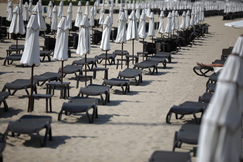 Tourist rests near empty sunbeds at Sunny Beach resort on the Black Sea