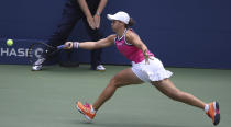 Ashleigh Barty, of Australia, stretches for a return against Qiang Wang, of China, during round four of the US Open tennis championships Sunday, Sept. 1, 2019, in New York. (AP Photo/Kevin Hagen)